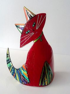 Paul Palango's premium cats feature dichroic mosaic tails, forelegs and ears. Each cat is all glass and comes in a variety of usually opaque colors -- red, cobalt, black, persimmon and peacock green. Approx. 13 w x 13 h, by 6 inches deep