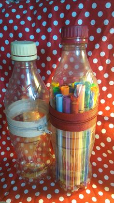 Cute pencil cases made from bottles with a glued on zipper(used E6000 glue, hot glue will not hold in the long run...)