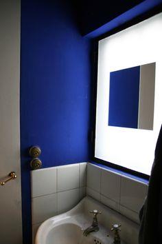 The blue bathroom of Maison La Roche, designed by Le Corbusier.