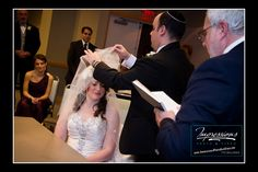Photo by Impressions Photo and Video http://impressionsphotoandvideo.com #KetubaSigning #JewishWeddingTraditions
