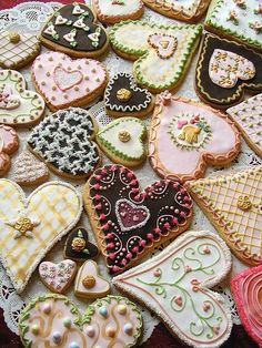 Pretty heart cookies~❥   great decorating ideas! With some royal icing and edible toppings... these are very do-able.