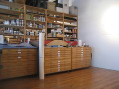 Love to have this studio space....along with all those flat file units...I'd have doors on the shelving units to hide the clutter! Love....