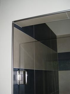 """I'm thinking of doing this and I'm pretty sure I've seen photos of it. I'm not sure if the tile would go to the ceiling or not. If not, how does it """"end""""? I mean, I assume they don't make bullnose for these tiles, correct? Does anyone know what I'm talking about, or should I go find some p... Master Shower, Tile Floor, Tiles, Ceiling, Flooring, Mirror, Pretty, Wall, Photos"""