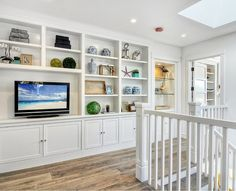 California Beach Cottage. Upper Hall: You will find an extensive built-in bookcase as soon you get to the second level of the cottage.