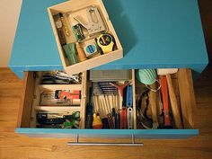 Turn an old dresser into a rolling tool cabinet!! This would be perfect for all the crafting tools and supplies my girls use ;)