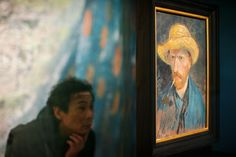 A visitor looks at a self portrait of Dutch Post-Impressionist painter Vincent van Gogh on the ground floor of the Vincent van Gogh museum on November 25, 2014 in Amsterdam, Netherlands. The new presentation of the permanent collection of Vincent van Gogh (1853-1890) works focuses on the development of the artist and the myths surrounding Van Gogh's suicide, illness and ear are discussed in detail for the first time at the museum. On the ground floor of the museum, visitor's first walk ...