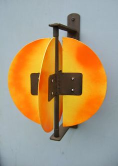 "Aluminum and copper wind sculpture ""Yellow Sun"" mounts to a wall, post, fence or any vertical surface and turns in the wind. Free shipping !"