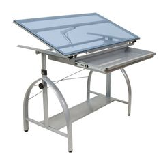 The Studio Designs 10060 Avanta series adjustable glass top drafting table with metal legs is an excellent choice for artists and interior designers. This modern drafting table is sure to add aesthetic value to any space. Medan, Metal Design, Modern Design, Industrial Design, Glass Top Desk, Pc Table, Drafting Desk, Drafting Tables, Drafting Drawing