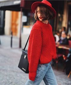 red chunky sweater + red hat +blue jeans + black leather bag