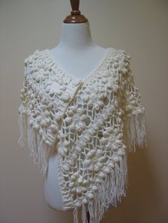 Lacy crochet poncho is surprisingly warm when made from fine wool or cashmere yarn