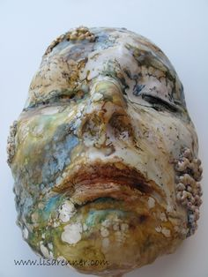 Lisa Renner's face in plaster: once the process was complete she applied encaustic over the surface, incorporating a shellac-burn to render the finished result.