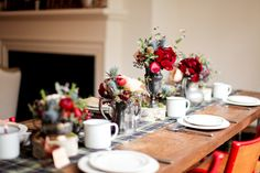 Great fall table. The plaid looks sweet and modern with the punchy red blooms.