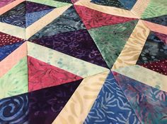 Looking for a project that sews up in a snap? This free mini-quilt tutorial uses a few charm squares and will be finished before you know it.