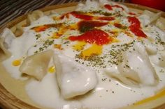 this is the girls' absolute favorite Turkish food -- manti. it's a meat dumpling with garlic yogurt sauce with a sprinkle of dried mint, sumac, and a little butter tomato sauce and crushed red pepper. Yogurt Sauce, Food Test, Middle Eastern Recipes, Turkish Recipes, Dumpling, Winter Food, International Recipes, Vegetable Dishes, Carne