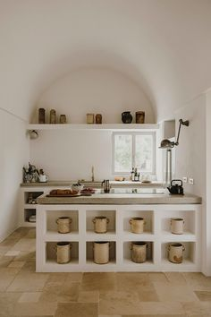Great interior design, build in shelving and the arched interior architecture, beautiful kitchen by photography by… Rustic Kitchen, New Kitchen, Kitchen Decor, Minimal Kitchen, Kitchen Tables, Kitchen Sink, Concrete Countertops, Cuisines Design, Cheap Home Decor