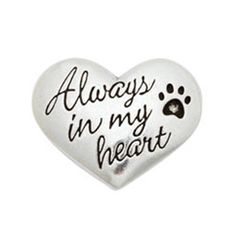 """Keep the memory of your beloved pet close to you, with this Heart Memorial Pocket Reminder. Made from handcrafted pewter, this heart-shaped pocket reminder is inscribed with """"Always in my Heart"""" and an inset paw print. Now every time you reach in your pocket, you'll remember the paw prints that your dear pet left in your heart."""
