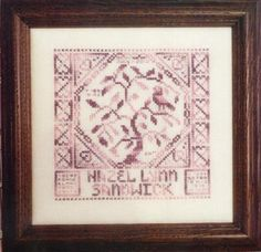 Quaker Birth Sampler is the title of this cross stitch pattern from Rosewood Manor Designs.
