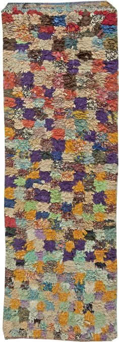 This circa-1940 vintage Moroccan runner rug features a bold raised pile multicolored all-over geometric design with eye-popping hues of purple, yellow and green.