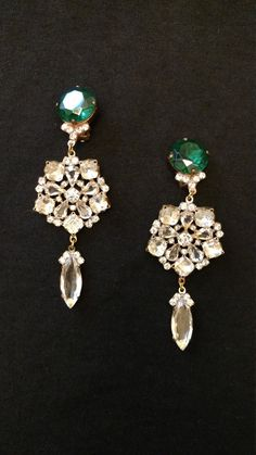 Absolutely stunning set is clip on earings. This would be an ideal Christmas gift or special touch for New Years Eve! NOT SIGNED   For centuries, the