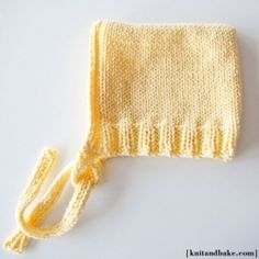 Knitting pattern for this easy-to-make baby bonnet / hoodie.
