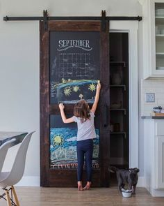 Shop the fun and practical Sliding Chalkboard Barn Door that is perfect for your kitchen, pantry or playroom. The two panel design brings added durability, shop for your chalkboard door today.