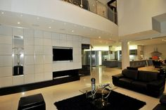 Amazing South African Modern Home Design with Hues: Authentic Cal Kempton Park With Concrete Black Fireplace Also Black Rug Under Glass Tabl. Small Living Rooms, Living Room Designs, Modern Minimalist Living Room, Minimalist Scandinavian, Scandinavian Living, Modern Living, Tv Built In, Black Fireplace, Luxury Homes Dream Houses