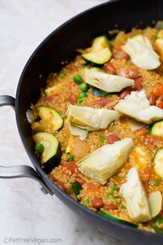 Quinoa Vegetable Paella.  Onion, garlic, quinoa, saffron, paprika, cumin, diced tomatoes, 1 bell pepper, red kidney beans, 3 cups stock, frozen peas, artichoke hearts.