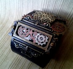 Chief Engineer's Ceremonial Cuff, steampunk leather cuff with GLOW in the DARK locket. $60.00, via Etsy.