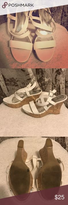 White Cork Wedge Sandals!! These cute/girlie/glam White Wedge Sandals feature a subtle but stunning metal silver toe. The cork wedge is extremely comfortable while the white strappy sandal is extremely fashionable. 😚I have only worn these shoes a few times. They are a size too big and make it difficult for me to wear. However, they are my most comfortable wedge and if they fit I would never let them go!!! 💙💚💛 Jennifer Lopez Shoes Sandals