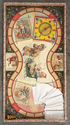 McLoughlin Bros. Game of Visit of Santa Claus, copyright 1897, 19 1/2'' x 10 1/2''. - Price Estimate: $800 - $1200