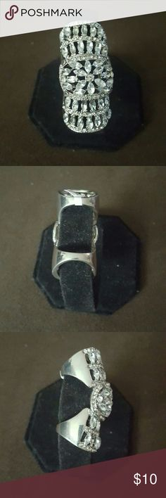 Double Ring This ring is unique,  it has a double ring and fits on one finger.It fits over the full length of the finger. Charlotte Russe Jewelry Rings