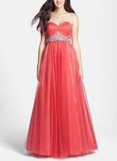 So pretty for prom! Love this red embellished strapless tulle ball gown.