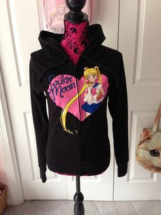 """Fight evil by moonlight in this hooded sweatshirt featuring Sailor Moon!  Size S Bust: 34-36"""" Sleeve: 24.5"""" Length: 24"""""""
