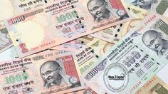 The Indian rupee opened marginally higher at 67.13 per dollar on Tuesday versus previous close 67.17.