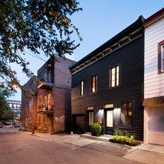 Architecture Open Form creates black facade for historic Montreal home