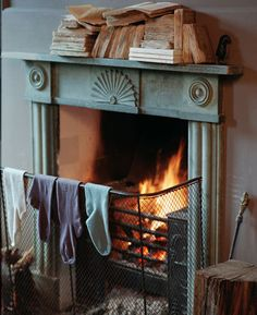 I remember my Mum airing our clothes like this, there's nothing better on a cold morning than putting clothes on that have been warmed in front of the fire ;)
