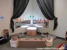 Reggio Emilia Classroom Design, love the mirrors above the light table!