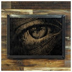 """Here's looking at you, kid...    20/20 is a highly detailed close up etching of a an eye that you know has seen some stuff.... Hard and slightly aggressive... just like the steel and wood that it's made from.    Made-To-Order    Made from oak that has each been sanded smooth and painted, the image is created by ripping away the pigment, leaving the beautiful texture of the wood undisturbed.    The frame is welded 1-1/4"""" steel angle, with a light grinding, for a very industrial feel.    As…"""