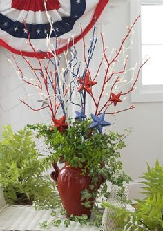 Red White and Blue branches with stars hanging from them ...great for 4th of July front porch décor.