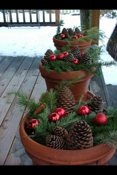 Winter decor for outdoor planters. This is what you do after your annuals are done! Adorable