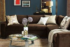 i love the blue walls and brown couch so warm and cozy blue walls brown furniture