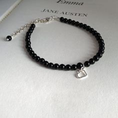 Onyx beads.  Sterling silver bracelet by PetitsBijouxGems, £20.00