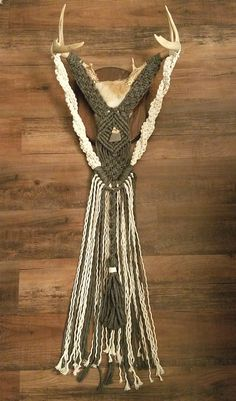 This is a two tone macrame done on a deer antler trophy by MacuNana