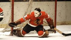 Tony Esposito: 100 Greatest NHL Players Three-time Vezina Trophy winner holds Blackhawks records for shutouts, victories Blackhawks Hockey, Hockey Goalie, Chicago Blackhawks, Bobby Hull, Hockey Room, Goalie Mask, Stanley Cup Playoffs, Vancouver Canucks, National Hockey League
