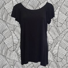• 90s Banana Republic black t-shirt • pleated neckline • rayon/spandex mix • flowy short sleeves • size M • neckline: 14 • bust: 34 (with stretch) • length: 21 • sleeve: 6   a great wide neckline accentuated with tailored pleats - and those great swingy sleeves!   ❉ ❉ ❉   check out www.instagram.com/vintish.nyc for other amazing post-90s items!   ❉ ❉ ❉  as with all vintage items, expect some wear. i inspect everything to make sure its just as described, but im happy to send addition...