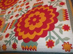 Close-up, antique folk art whig rose quilt, mid 19th century.  Spotted at Ebay in 2011; posted by Jan at Be*mused