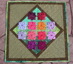 https://flic.kr/p/4Lymwn   Spring Flower Bed quilt   Very late, but hopefully my swap partner will like it.  Blogged about here: www.lemontreetales.com/lemon_tree_tales/2008/05/spring-fl...
