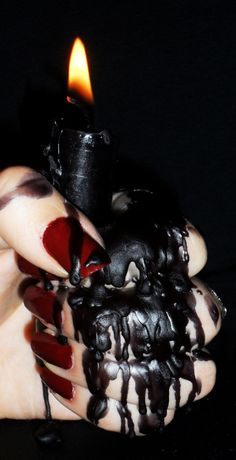 We love the way the black wax has melted over the fingers and red nail polish.