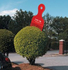 Alliance Theatre Advertisement: To advertise the Alliance Theatre's production of a play about an African-American barber shop, a series of five-foot-tall sculptures were created and then placed in large shrubs and bushes around the city of Atlanta.