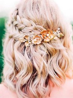 If you want to look unique at you prom night, try this beautiful flower hair accessory. #wavyhair #hairstyle